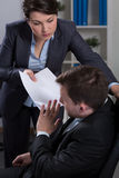 Psychological terror in corporation. Worker being victim of psychological terror in corporation Royalty Free Stock Photo