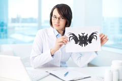 Psychological test. Psychiatrist showing picture to patients Stock Images