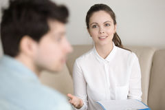 Psychological therapy, female psychotherapist cheering up depres Royalty Free Stock Photo