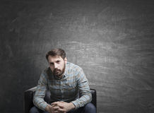 Psychologist in armchair near chalkboard Royalty Free Stock Images