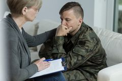 Psychologist and despair soldier Royalty Free Stock Image