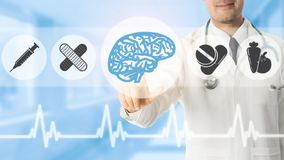 Psychologist Doctor Pointing at Brain Symbol Icon. On blue hospital background. Medical psychologist , brain diagnosis and healthcare concept Royalty Free Stock Photo