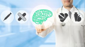 Psychologist Doctor Pointing at Brain Symbol Icon. On blue hospital background. Medical psychologist , brain diagnosis and healthcare concept Stock Image