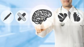 Psychologist Doctor Pointing at Brain Symbol Icon. On blue hospital background. Medical psychologist , brain diagnosis and healthcare concept Stock Images