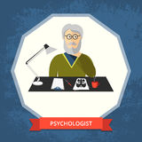 Psychologist with glasses at his workspace. Stock Image