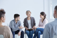 Psychologist helping his patients. With anxiety disorder stock image