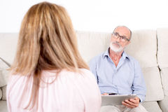 Psychologist listening to elderly woman Royalty Free Stock Image