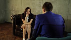 Psychologist listening to woman in trouble during therapy session. Psychotherapist understanding problems of a woman stock video