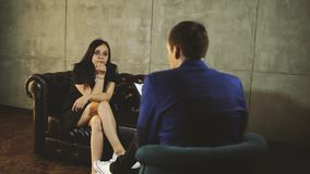 Psychologist listening to woman in trouble during therapy session. Psychotherapist understanding problems of a woman stock video footage