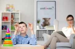 Free Psychologist Observing Autistic Boy Stock Image - 95150461
