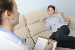 Psychologist or psychiatrist with patient Stock Photography