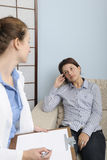 Psychologist or psychiatrist with patient Royalty Free Stock Photos