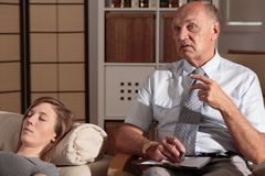 Psychologist's help. Psychologist is trying to explain to patient her problem stock photo