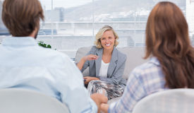 Psychologist speaking to a couple. During a session Stock Photography