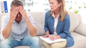 Psychologist talking with depressed man. In the office stock footage