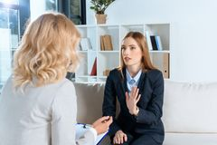 psychologist talking with emotional young woman royalty free stock image