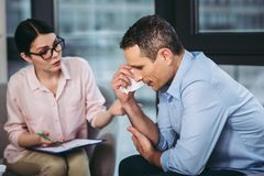 Psychologist talking with patient stock photography