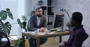 Psychologist talking to young man stock photos