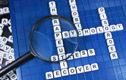 Psychology. Related words and magnifying glass on game board royalty free stock photo