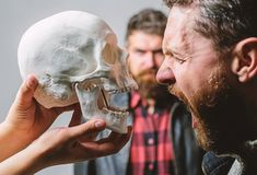 Psychology concept. Human fears and courage. Looking deep into eyes of your fear. Man brutal bearded hipster looking at. Skull symbol of death. Overcome your royalty free stock images