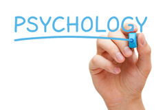 Psychology Hand Blue Marker. Hand writing the word Psychology with blue marker on transparent wipe board royalty free stock images
