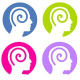 Psychology Mind Spirals. An illustration featuring 4 colourful head silhouettes within circles and decorated with swirls Stock Images