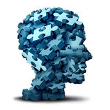 Psychology Puzzle. Concept as a a group of 3D illustration jigsaw pieces shaped as a human head as a mental health symbol for psychiatry or psychology and brain Stock Image
