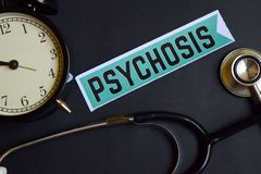 Psychosis on the print paper with Healthcare Concept Inspiration. alarm clock, Black stethoscope. royalty free stock photography
