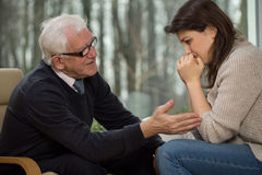 Psychotherapist comfort his client royalty free stock photos