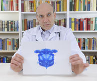 Psychotherapist holding Rorschach Test Stock Photo