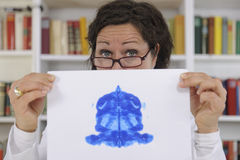 Psychotherapist holding Rorschach Test Stock Images