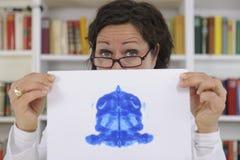 Psychotherapist holding Rorschach Test. Female psychotherapist holding Rorschach Test Stock Images