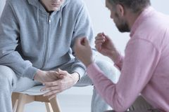 Psychotherapist talking with rebellious teenager Royalty Free Stock Photography