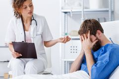 Psychotherapy nurse helping crying patient royalty free stock photography