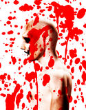 Psychotic With Blood. A Psychotic male who is covered in blood Royalty Free Stock Images