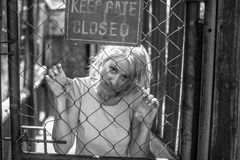 Psychotic woman in the cage Stock Photo