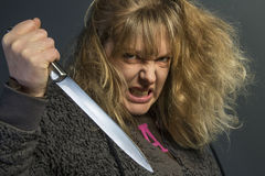 Psychotic Woman. A crazy psychotic young woman - domestic violence Royalty Free Stock Photos