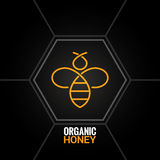 Pszczoła logo na honeycomb tle Zdjęcia Royalty Free
