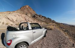 PT Cruiser At Boundary Cone In Arizona Stock Photos