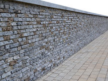 Pt-Isolated wall of bricks with granite paving tiles in perspect Royalty Free Stock Photo