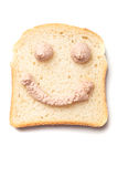 Pâté spread smiley on slice of bread Royalty Free Stock Photo