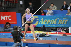 Ptacnikova Jirina - czech pole vaulter. Wins first place with Nation Rekord 4.70 on Samsung Pole Vault Stars meeting on February 11, 2012 in Donetsk, Ukraine Royalty Free Stock Photography