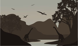Pterodactyl and brachiosaurus silhouette in river Royalty Free Stock Images