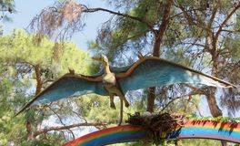 Pterodactyl flew to the nest. In the Dinopark Stock Photo