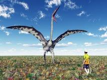 Pterosaur Quetzalcoatlus和一个鲁莽的游人 库存图片
