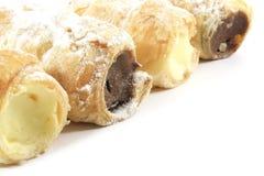 pâtisseries de klaxon remplies par crème Images libres de droits