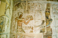Ptolemy offering to Amun. Ancient Egyptian bas relief showing the Pharaoh Ptolemy IV making an offering to Amun.  Deir el Medina temple, Luxor, Egypt Stock Photography