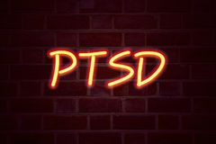 PTSD Post-Traumatic Stress Disorder  neon sign on brick wall background. Fluorescent Neon tube Sign on brickwork Business concept. For Health Treatment 3D Stock Images