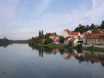 Ptuj (Slovenia). A scene of the village of Ptuj, Slovenia with river and houses and wispy clouds stock photography