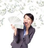 Puñado de la mirada de la mujer de negocios de dinero Foto de archivo libre de regalías